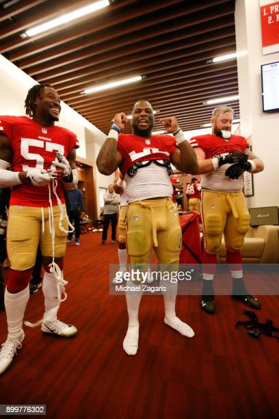 Eli Harold and Carlos Hyde of the San Francisco 49ers celebrate in the locker room following the game against the Jacksonville Jaguars at Levi's...