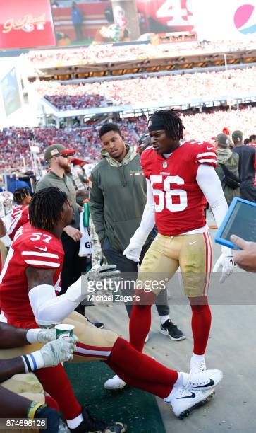 Eli Harold and Reuben Foster of the San Francisco 49ers talk on the sideline during the game against the New York Giants at Levi's Stadium on...