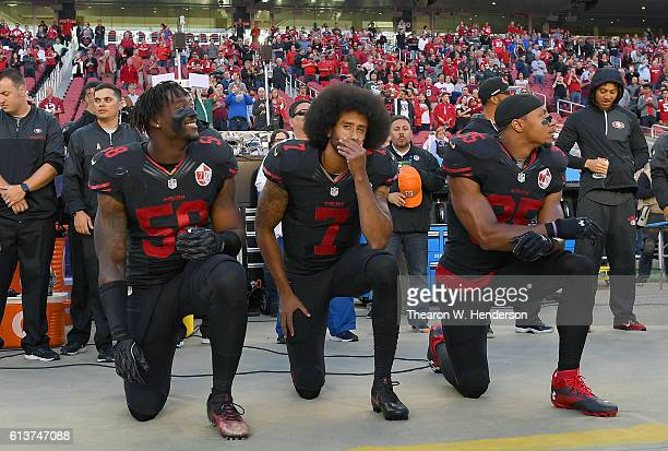 Eli Harold Colin Kaepernick and Eric Reid of the San Francisco 49ers kneel in protest during the national anthem prior to their NFL game against the...
