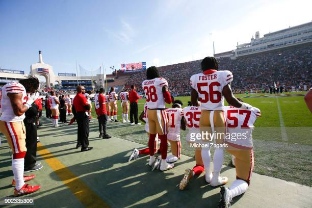 Eli Harold Eric Reid Marquise Goodwin and Louis Murphy of the San Francisco 49ers kneel during the anthem as Reuben Foster and Adrian Colbert stand...