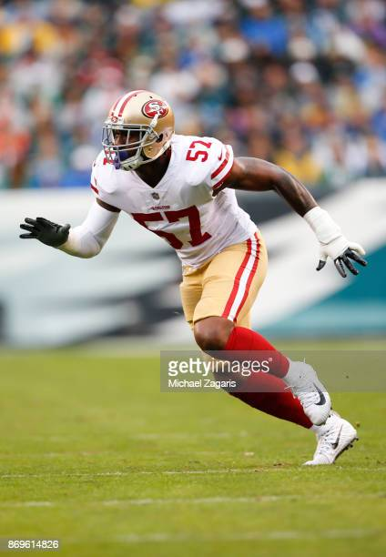 Eli Harold of the San Francisco 49ers blitzes the quarterback during the game against the Philadelphia Eagles at Lincoln Financial Field on October...