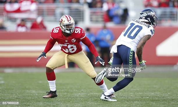 Eli Harold of the San Francisco 49ers defends during the game against the Seattle Seahawks at Levi Stadium on January 1 2017 in Santa Clara...