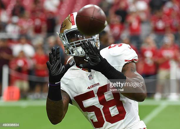 Eli Harold of the San Francisco 49ers prepares for a game against the Arizona Cardinals at University of Phoenix Stadium on September 27 2015 in...