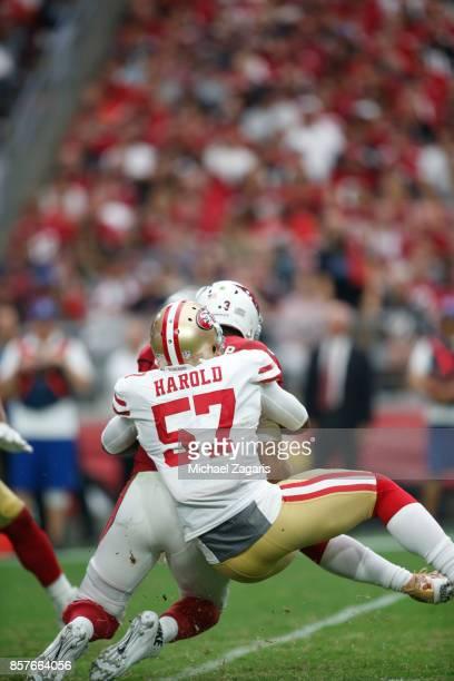 Eli Harold of the San Francisco 49ers sacks Carson Palmer of the Arizona Cardinals during the game at the University of Phoenix Stadium on October 1...