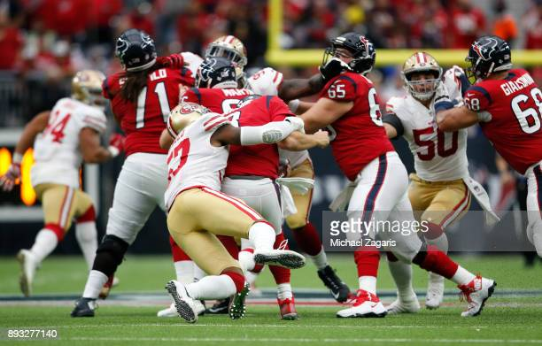 Eli Harold of the San Francisco 49ers sacks Tom Savage of the Houston Texans during the game at NRG Stadium on December 10 2017 in Houston Texas The...
