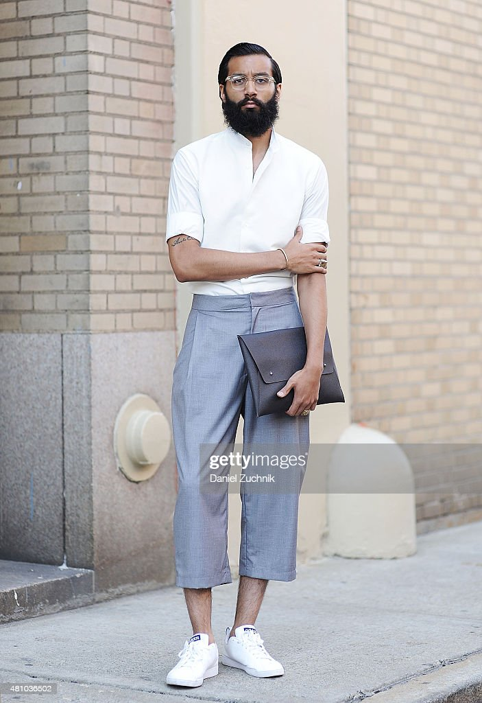 Eli Infante is seen outside the Capsule show wearing a Waraire Boswell top, Oak and Fortman pants and Adidas sneakers during New York Fashion Week: Men's S/S 2016 on July 16, 2015 in New York City.
