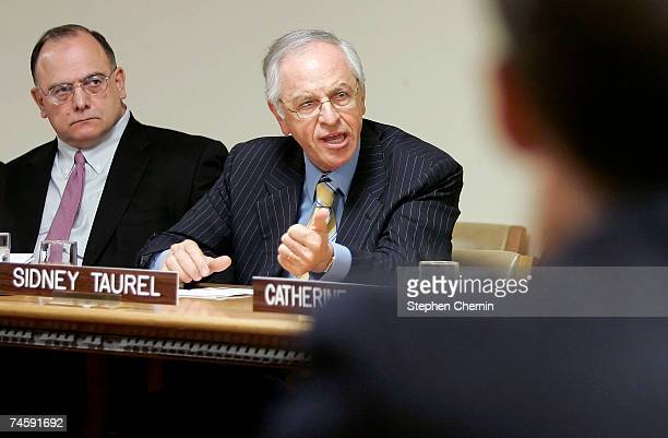 Eli Lilly Company Chairman Sidney Taurel speaks as Marathon Oil President and CEO Clarence Cazalot Jr listens during a Global Business Coalition...