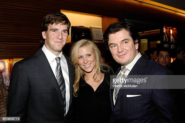 Eli Manning, Abby McGrew and Djordje Stefanovic attend ERMENEGILDO ZEGNA Store Opening Cocktail Party For The Robin Hood Foundation at Ermenegildo...