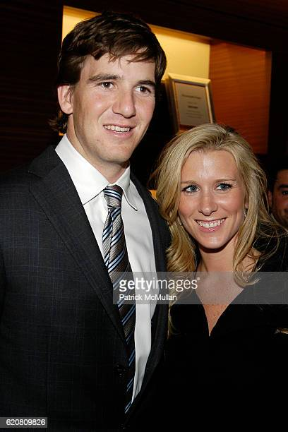 Eli Manning and Abby McGrew attend ERMENEGILDO ZEGNA Store Opening Cocktail Party For The Robin Hood Foundation at Ermenegildo Zegna Store 5th Ave on...