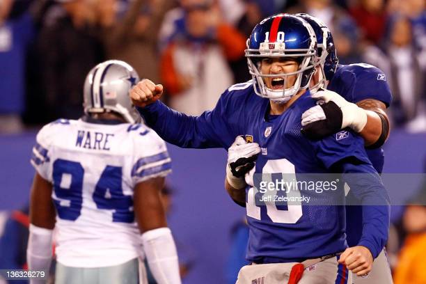 Eli Manning and David Diehl of the New York Giants celebrate after a passing touchdown in the fourth quarter at MetLife Stadium on January 1 2012 in...