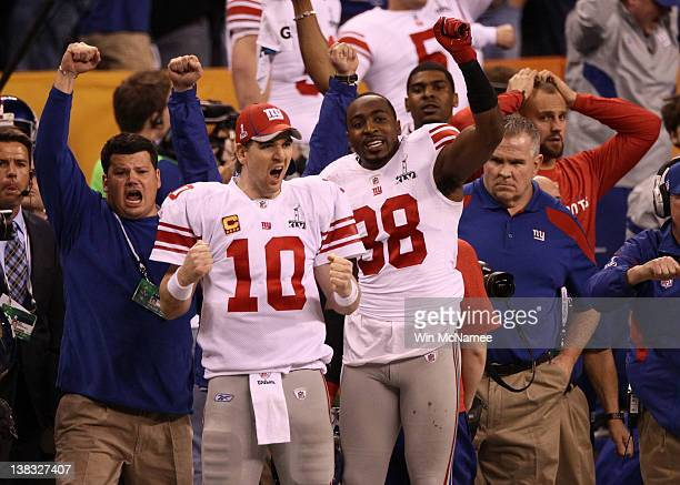 Eli Manning and Hakeem Nicks of the New York Giants celebrate after defeating the New England Patriots 2117 during Super Bowl XLVI at Lucas Oil...
