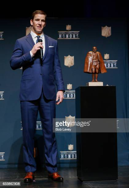 Eli Manning answers questions after winning the Walter Payton NFL Man of the Year presente by Nationwide at Wortham Theater Center on February 4,...