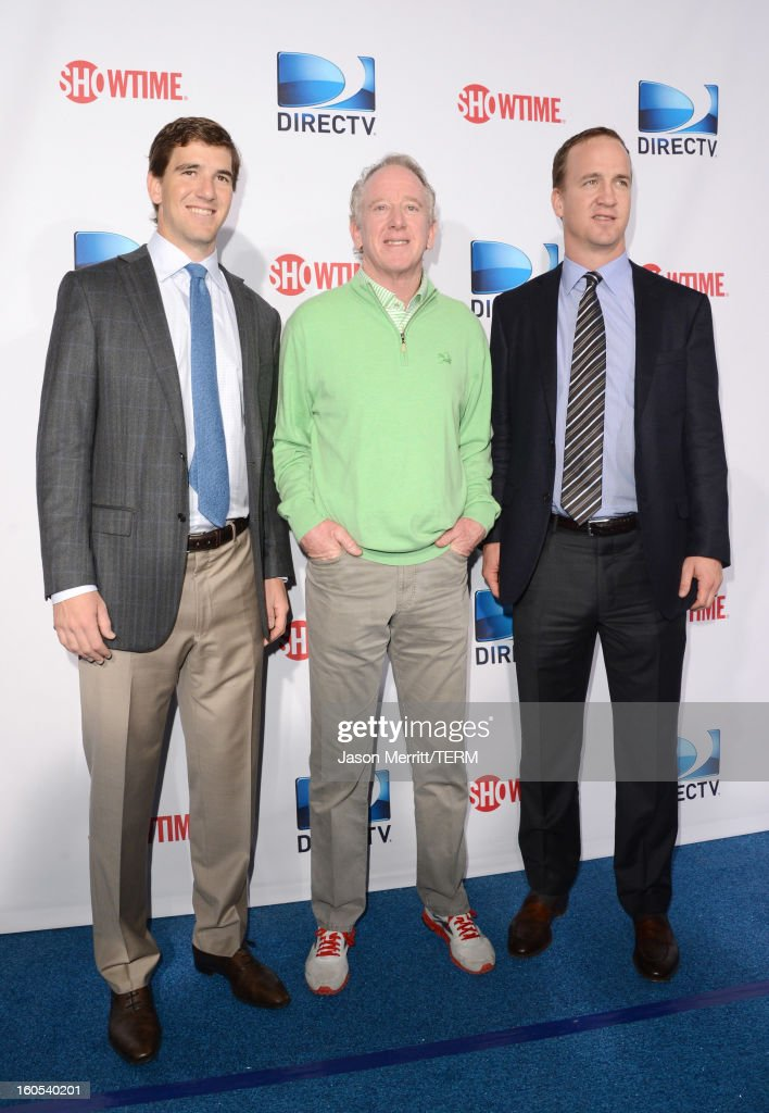 Eli Manning, Archie Manning and Peyton Manning attends DIRECTV'S Seventh Annual Celebrity Beach Bowl at DTV SuperFan Stadium at Mardi Gras World on February 2, 2013 in New Orleans, Louisiana.