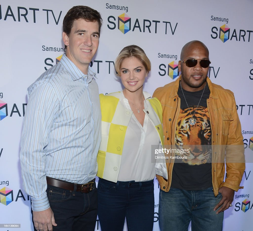 Eli Manning, Kate Upton and Flo Rida attend the Samsung 2013 Television Line Launch Event at the Museum Of American Finance on March 20, 2013 in New York City.