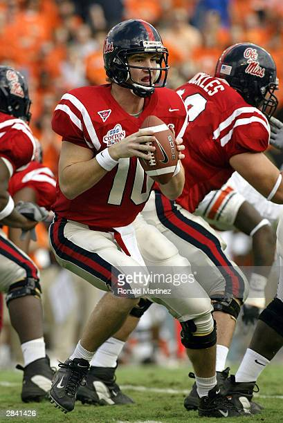 Eli Manning of the Mississippi Rebels drops back to pass against the Oklahoma State Cowboys during the SBC Cotton Bowl on January 2 2004 in Dallas...