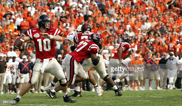 Eli Manning of the Mississippi Rebels throws a pass against the Oklahoma State Cowboys during the SBC Cotton Bowl on January 2 2004 in Dallas Texas...