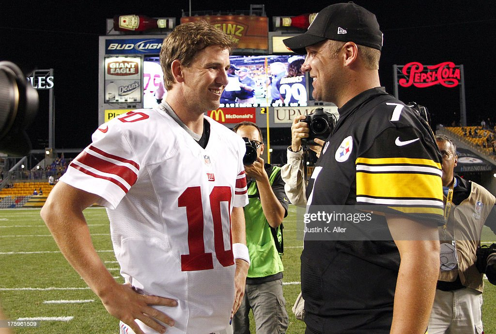 Eli Manning #10 of the New York Giants and Ben Roethlisberger #7 of the Pittsburgh Steelers talk after the game on August 10, 2013 at Heinz Field in Pittsburgh, Pennsylvania.