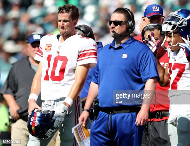 Eli Manning of the New York Giants and head coach Ben McAdoo wait for the review on a touchdown scored in the second quarter by the New York Giants...