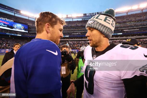 Eli Manning of the New York Giants and Nick Foles of the Philadelphia Eagles meet after the eagles 3429 win at MetLife Stadium on December 17 2017 in...