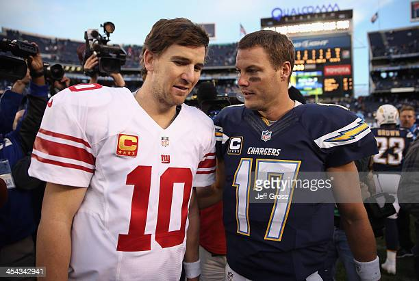 Eli Manning of the New York Giants and Philip Rivers of the San Diego Chargers come together at the conclusion of the game at Qualcomm Stadium on...