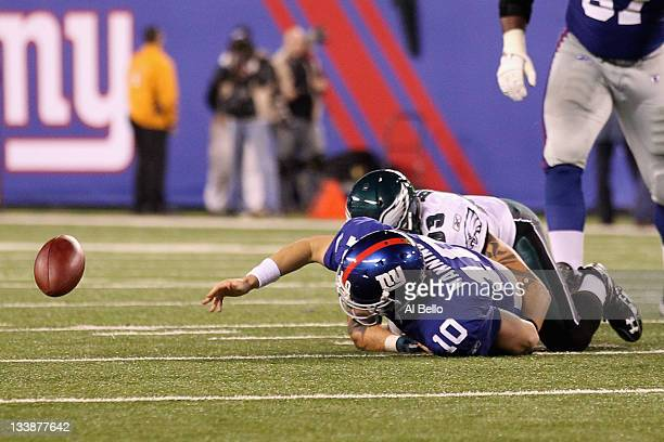 Eli Manning of the New York Giants fumbles the ball late in the fourth quarter against Jason Babin of the Philadelphia Eagles at MetLife Stadium on...