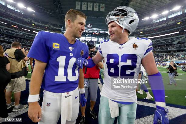 Eli Manning of the New York Giants greets Jason Witten of the Dallas Cowboys after the Cowboys beat the Giants 3517 at ATT Stadium on September 08...