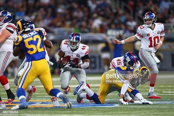 Eli Manning of the New York Giants hands the ball off to Andre Williams of the New York Giants during the second quarter against the St Louis Rams at...