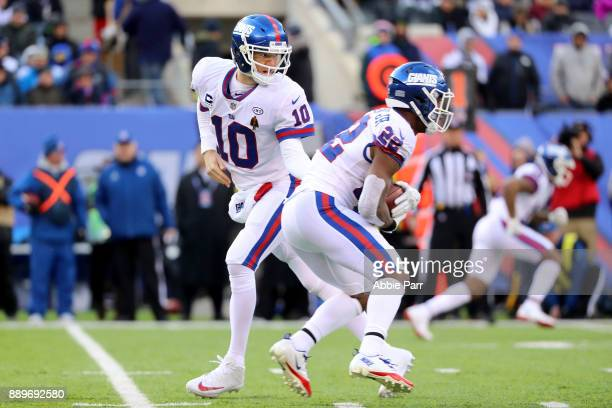 Eli Manning of the New York Giants hands the ball off to Wayne Gallman of the New York Giants in the first half during their game at MetLife Stadium...