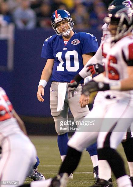 Eli Manning of the New York Giants hangs his head after an incompletion in the first quarter against the Atlanta Falcons at Giants Stadium on...