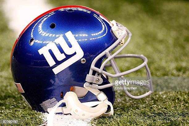 Eli Manning of the New York Giants' helmet rests on the field prior to their NFL game against the New Orleans Saints at the Louisiana Superdome on...