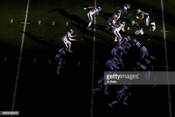 Eli Manning of the New York Giants hikes the ball against the Dallas Cowboys in the first half during the game at MetLife Stadium on December 10 2017...