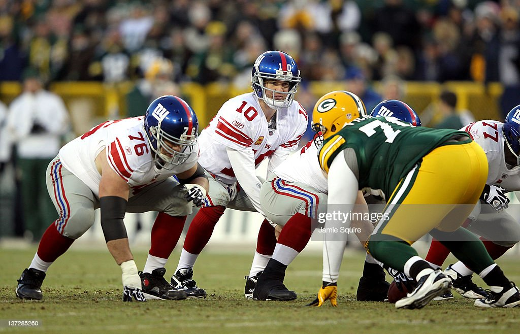 c7844f589 Eli Manning of the New York Giants hikes the ball against the Green ...