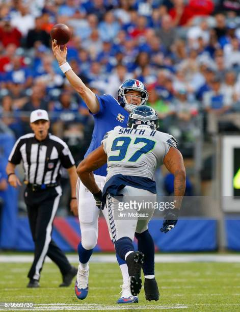 Eli Manning of the New York Giants in action against Marcus Smith II of the Seattle Seahawks on October 22 2017 at MetLife Stadium in East Rutherford...