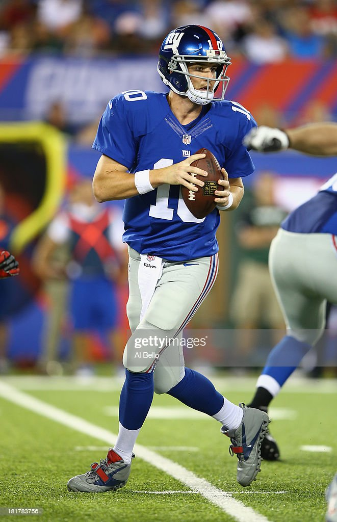 Eli Manning #10 of the New York Giants in action against the New York Jets during their pre season game at MetLife Stadium on August 24, 2013 in East Rutherford, New Jersey.