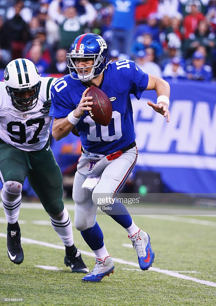 Eli Manning #10 of the New York Giants in action against the New York Jets during their game at MetLife Stadium on December 6, 2015 in East Rutherford, New Jersey.