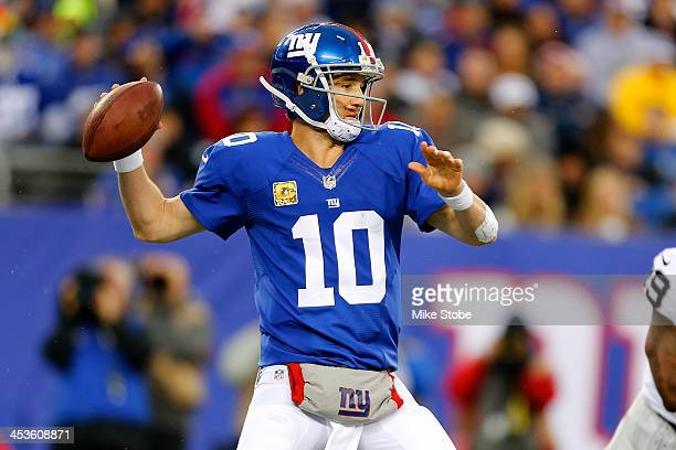 Eli Manning of the New York Giants in action against the Oakland Raiders at MetLife Stadium on November 10 2013 in East Rutherford New Jersey Giants...