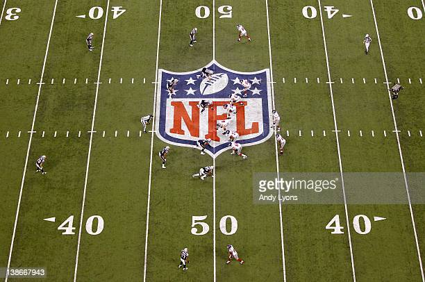 Eli Manning of the New York Giants lines the offense up in the shotgun formation against the New England Patriots during Super Bowl XLVI at Lucas Oil...