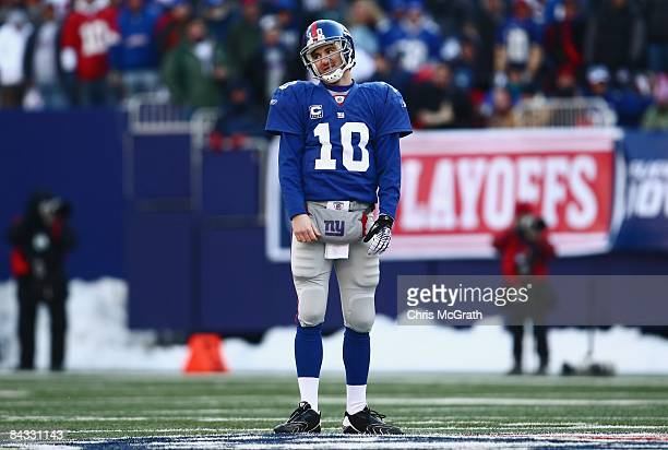 Eli Manning of the New York Giants looks on against the Philadelphia Eagles during the NFC Divisional Playoff Game on January 11, 2009 at Giants...