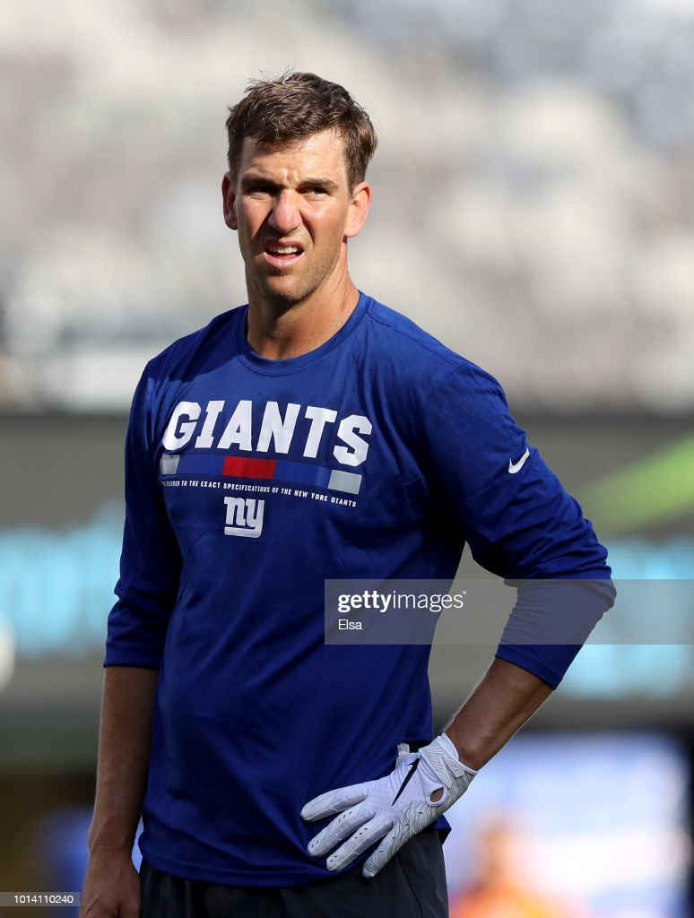 Eli Manning #10 of the New York Giants looks on during warm ups before their preseason game against the Cleveland Browns on August 9,2018 at MetLife Stadium in East Rutherford, New Jersey.