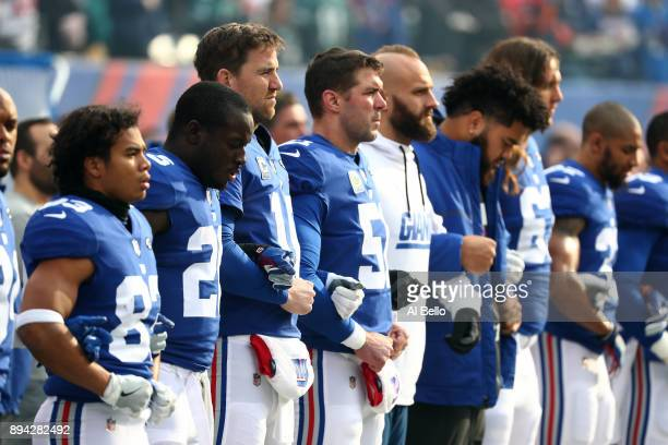 Eli Manning of the New York Giants looks on with his teammates prior to the game against the Philadelphia Eagles at MetLife Stadium on December 17...