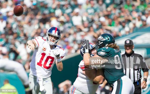 Eli Manning of the New York Giants passes the ball against Beau Allen of the Philadelphia Eagles in the second quarter at Lincoln Financial Field on...