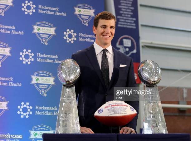 Eli Manning of the New York Giants poses with the Vince Lombardi Trophies after a press conference to announce his retirement on January 24, 2020 at...