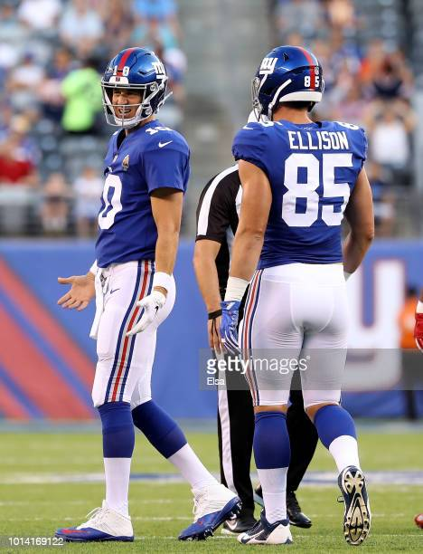 Eli Manning of the New York Giants reacts in the first quarter after a play as teammate Rhett Ellison stands by during their preseason game on August...