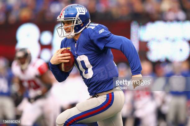 Eli Manning of the New York Giants runs the ball against the Atlanta Falcons during their NFC Wild Card Playoff game at MetLife Stadium on January 8,...
