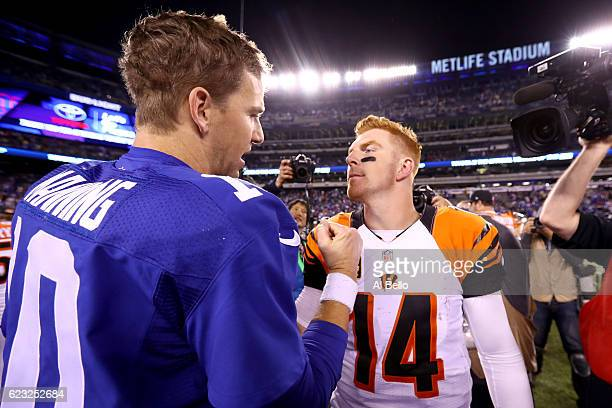 Eli Manning of the New York Giants shakes hands with Andy Dalton of the Cincinnati Bengals after the game at MetLife Stadium on November 14 2016 in...