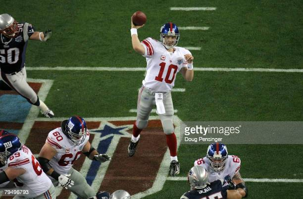Eli Manning of the New York Giants throws a pass against the New England Patriots during Super Bowl XLII on February 3, 2008 at the University of...