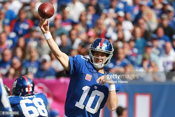 Eli Manning of the New York Giants throws a pass against the Baltimore Ravens during the first half of the game at MetLife Stadium on October 16,...