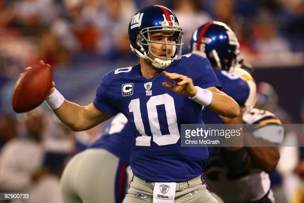 Eli Manning of the New York Giants throws a pass against the San Diego Chargers on November 8 2009 at Giants Stadium in East Rutherford New Jersey