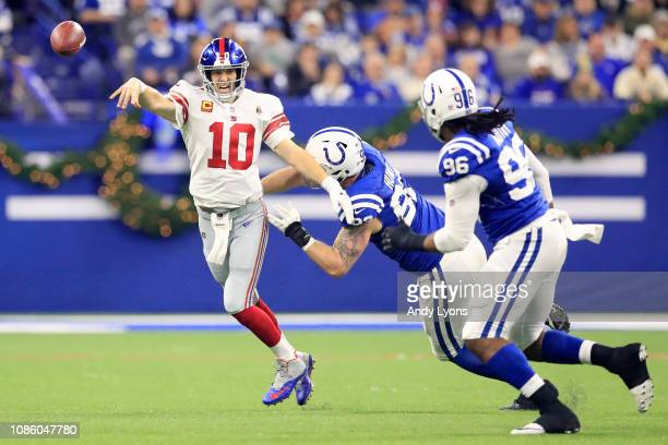 Eli Manning of the New York Giants throws a pass down field during the game against the Indianapolis Colts in the first quarter at Lucas Oil Stadium...