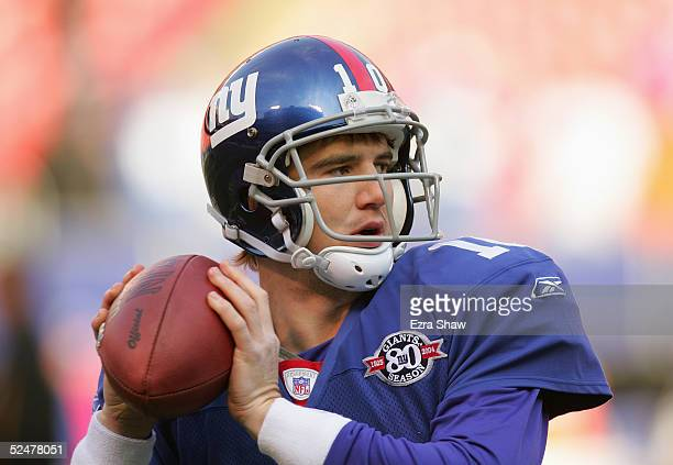 Eli Manning of the New York Giants warms up prior to the game against the Pittsburgh Steelers at Giants Stadium on December 18 2004 in East...